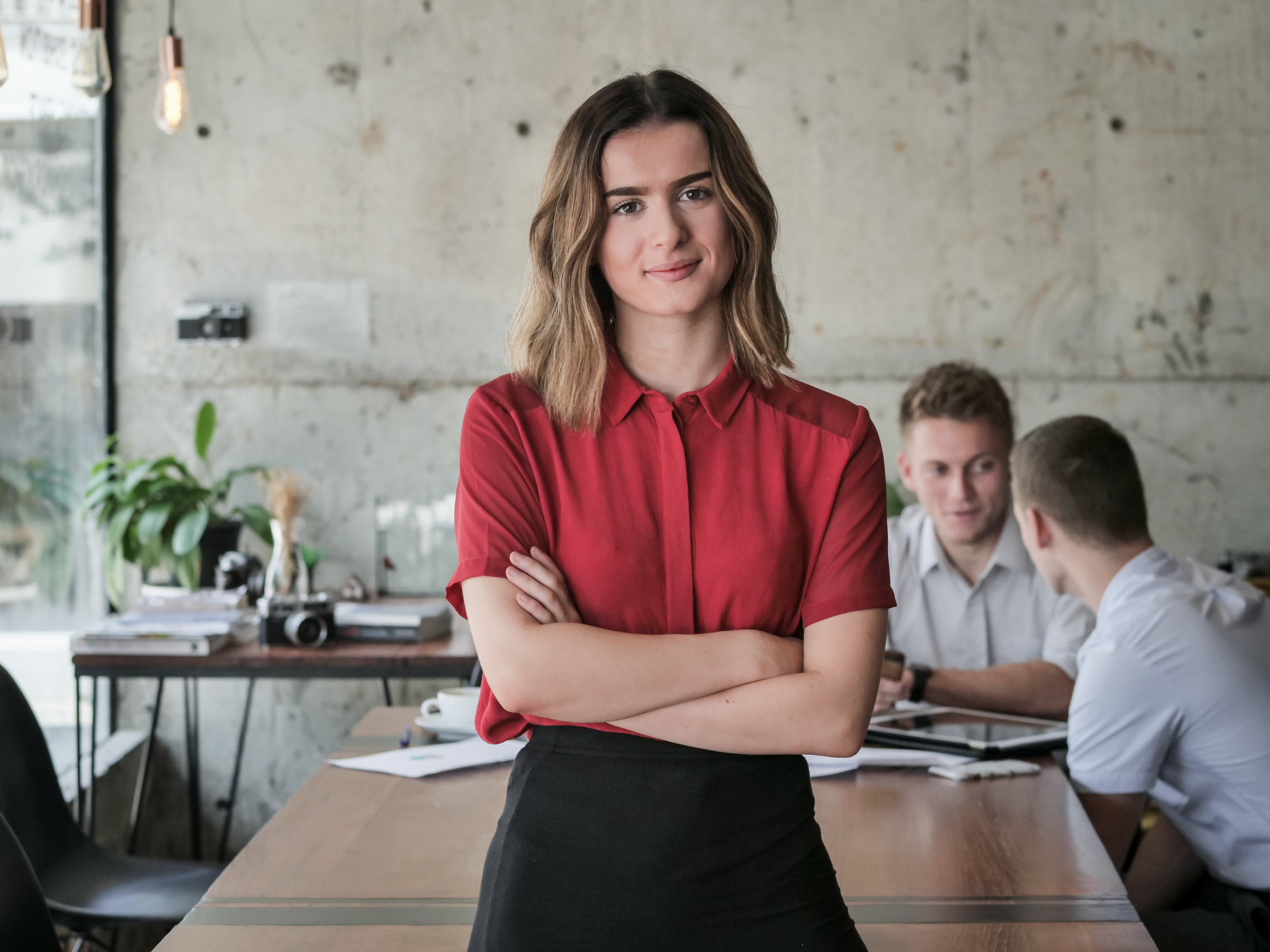 Successful young business woman start up, crossed arm and smiling in workplace